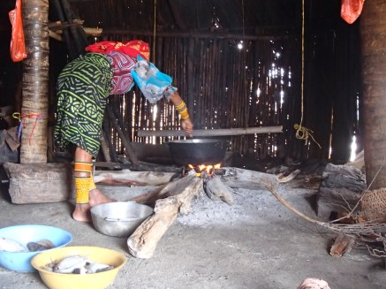 Ernestina cooking up come Dule Masi, traditional Guna food