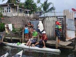 Curious Guna gather around the kayakers