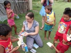 Suzannah distributing art supplies