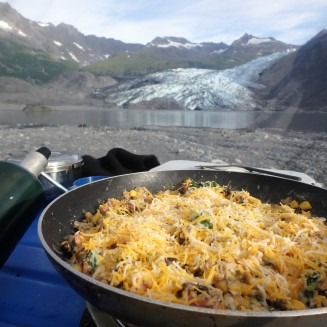 Breakfast of cheesy eggs with a view