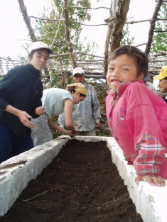 Planting seeds to help out, Ecuador, 2004