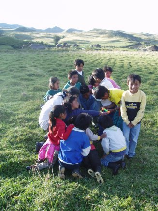 Kids captivated by bottle rockets in Ecuador, 2004