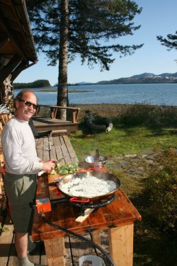 Chris, owner and chef at the lodge (making paella!)