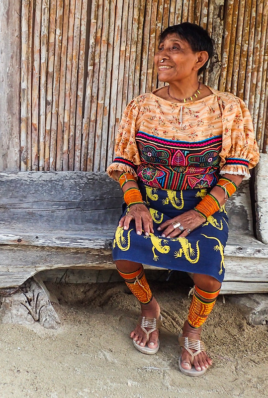 A beautiful traditionally-dressed Guna woman (hand-stitched mola panels on the front and back of her blouse)
